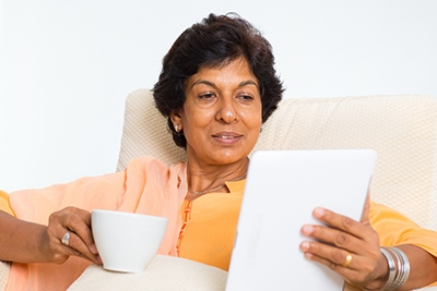 Foster carer keeping records on tablet